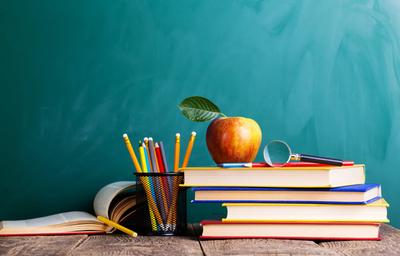 School Desk of Books and Pencils